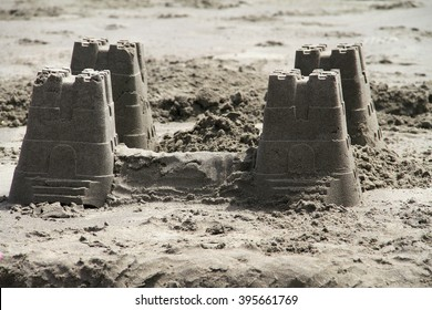 A small sand castle made out of buckets.