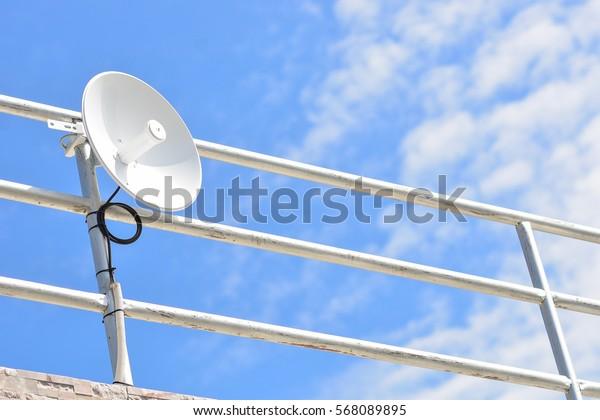 small satellite dish on blue sky