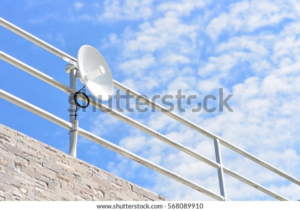 small satellite dish on blue sky
