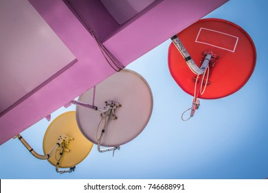 Small satellite dishes installed on the balcony for receiving high-definition television signal from bottom up view