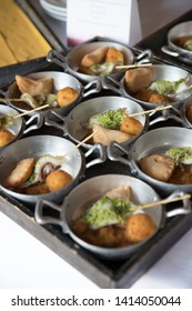 Small saucepans with tasty appetizers