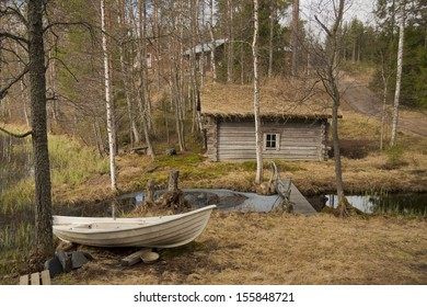 Small sauna and boat in the village of Southern Finland