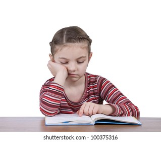 small school girl is bored by reading book during doing homework isolated on white