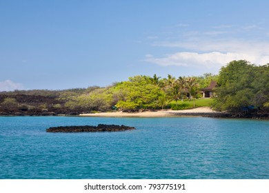 A small and secluded private beach near Makena in Maui, Hawaii. The area with its lava rock coastline is famous for snorkeling.