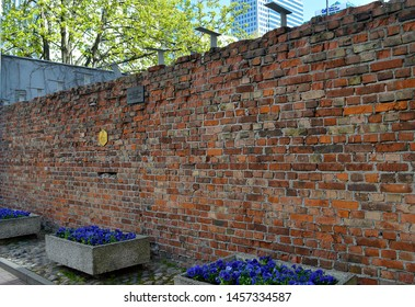 A small section of brick wall with commemorative plaques which is what remains of the wall enclosing the Warsaw ghetto following the almost total destruction of the area during the ghetto uprising.