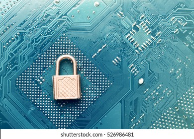 small security lock on computer circuit board - computer security concept
