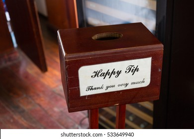 A small selfmade wooden tip box for the staff