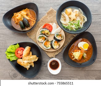 Small set of korean food include five food, kyoza, noodle, seafood soup, tokbokki, kimbub