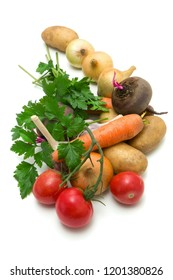 A small set of vegetables collected from garden beds on white background