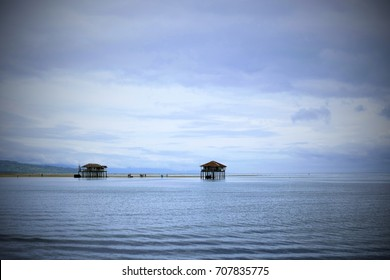 A small shelter standing in the middle of the sea. Photo taken in Manjuyod White Sandbar in Bais City, Philippines. Picture with vignette effects.
