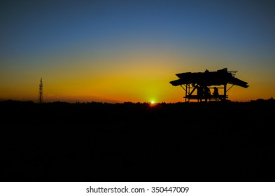 a small shelter with yellow evening sunset