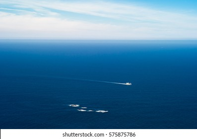 Small ship passing a reef at Cape West, Stad,  Norway