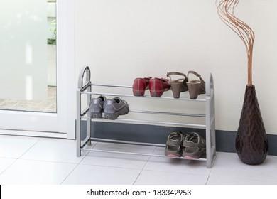 A small shoe shelf with women shoes