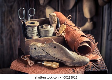 Small shoemaker workshop with shoes, laces and tools