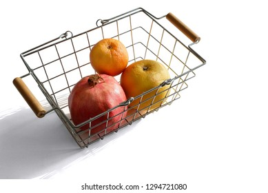 Small shopping basket with pomegranate, grapefruit and orange