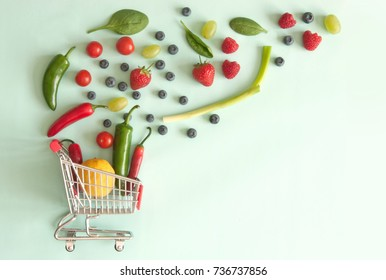 Small shopping cart with fruits and vegetables