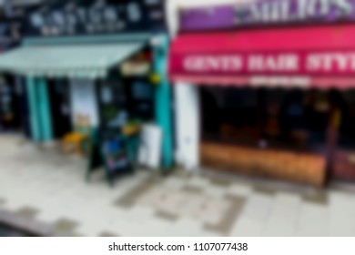 Small shops on old street of Greenwich. UK. Blurred view