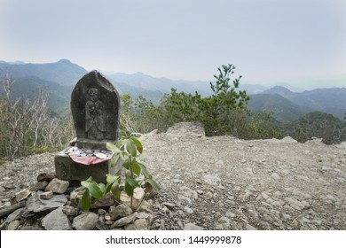 A small shrine on top of the rolling green mountain in Hongu area on the Kumano Kodo trail in Japan.