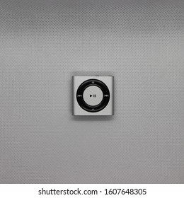 Small silver mp3 player on a white background