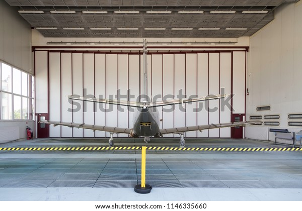 Small silver plane during his painting - back
