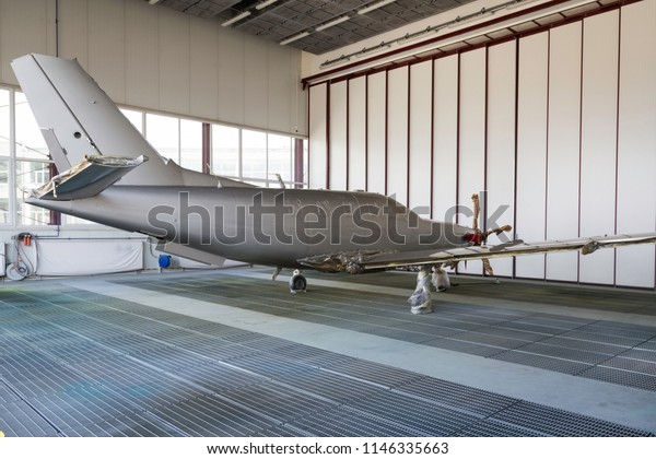 Small silver plane during his painting-side