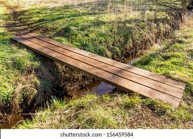 Small simple bridge over a stream