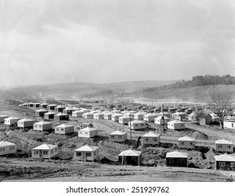 Small and simple homes under construction in Oak Ridge, Tennessee. Ca. 1945. They are for workers of the Manhattan Project's Clinton Engineering Works.