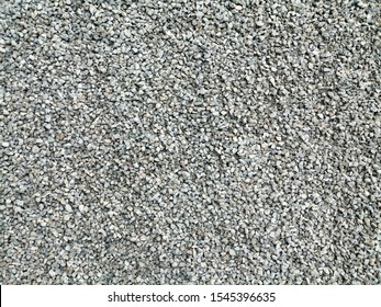 Small size crushed rock floor covering in medium grey.