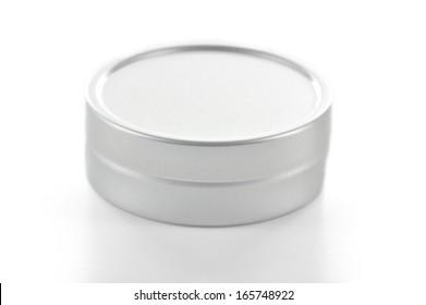 Small size metallic tin made with brushed aluminium on white background.