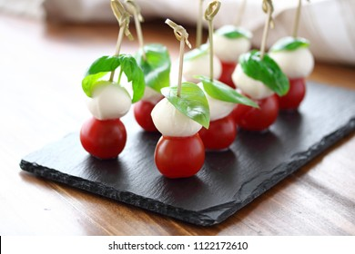 Small skewers with caprese salad
