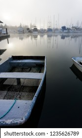 Small skiff on glass water in a boat harbor