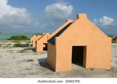 Small slave huts on Bonaire. Very small slave huts  built in the 18 th century on the shore, for the slave workers who worked in the salt-pans on Bonaire.