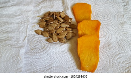 Small slices of pumpkin and a bunch of pumpkin seeds