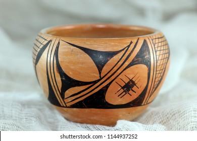 Small, smooth, Hopi hand-painted clay pot