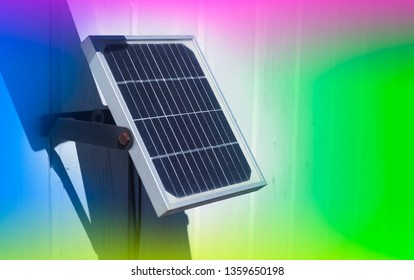 small solar panel with abstrct colors in background