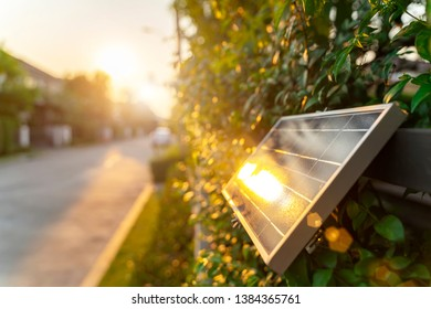 Small solar panel on wall with sunlight. Green energy in home concept.
