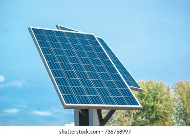 Small solar panels on metal pillars. Sun. Ecological electricity. Environment protection
