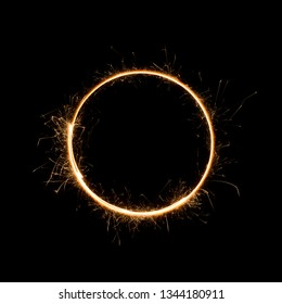 Small sparkler circle. Burning bengal fire round letter o number zero, isolated on black.
