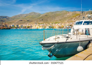Small speed boat moored on clear water of Aegonian Sea on Greek coast, Greece