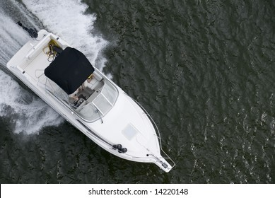 A small speedboat shot from above while travelling fast.
