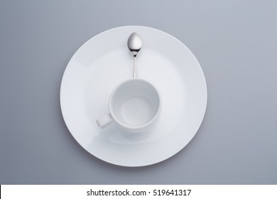 Small Spoon and Coffee Cup on white dish Composition form eight o'clock time for breakfast