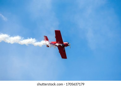 small sport aircraft perform acrobatics at air shows