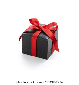 Small square gift box tied with red ribbon isolated on white background