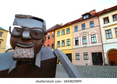 Small Square (Male namesti) in Hradec Kralove city, Czech Republic, bohemian region with the statue in the front. Dusk in the city.