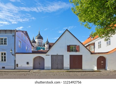 Small square with old buildings and church spire on Toompea hill in Tallinn, Estonia
