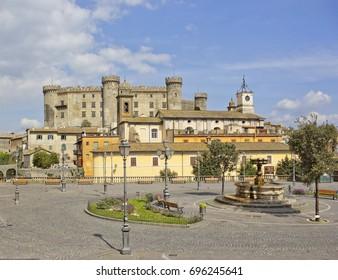 Small square with old castle on the background in Bracciano, Lazio, Italy