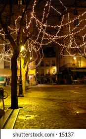 Small square in Paris at night near Christmas Time
