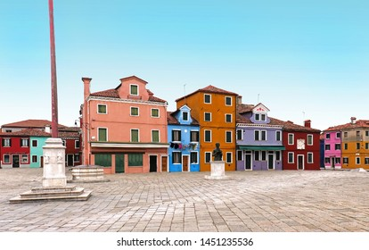Small square with retro colorful facades houses on Burano Island