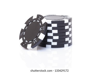 Small Stack of Black Poker Chips, closeup on white background