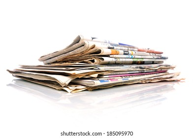 Small stack of international newspapers on white background